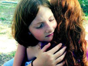 Upset Daughter Hugging Her Mother After Informed Consent Hurt Family Member